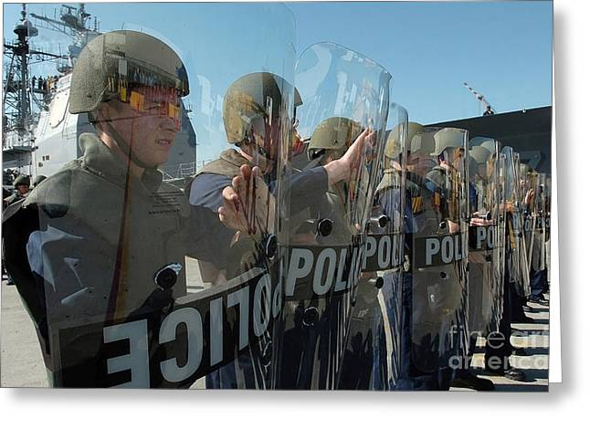 Law Enforcement Greeting Cards - A Riot Control Team Braces Greeting Card by Stocktrek Images