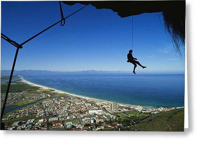 Cape Town Greeting Cards - A Rock Climber Dangles From A Rope Greeting Card by Bill Hatcher