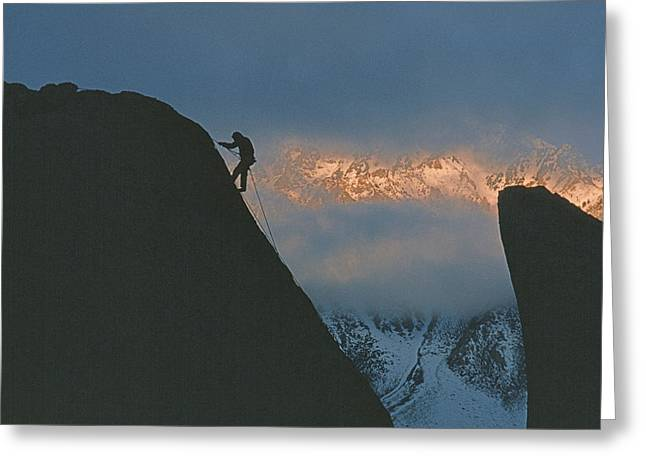 Rappel Greeting Cards - A Rock Climber Rappels Off Of A Boulder Greeting Card by Gordon Wiltsie