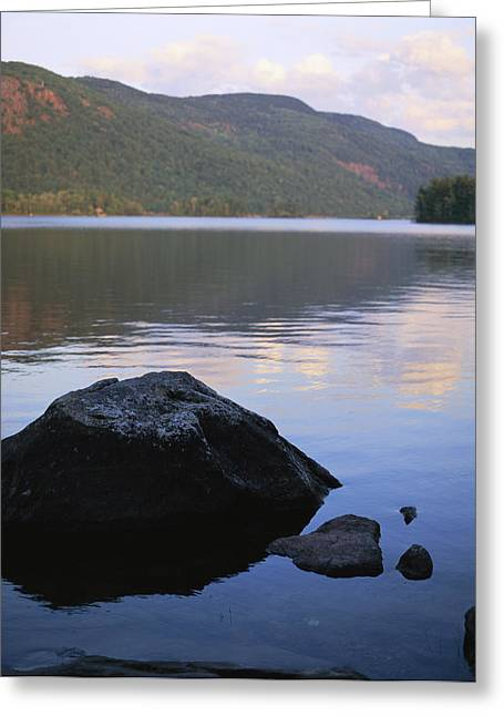 Maine Landscape Greeting Cards - A Rock Is In The Foreground Of A Lake Greeting Card by Stephen Alvarez