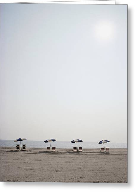 Benches And Chairs Greeting Cards - A row of empty chairs Greeting Card by Stephen St. John