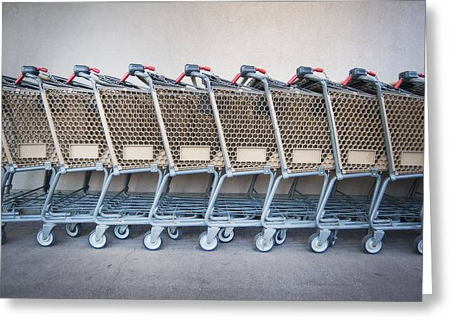Shopping Cart Greeting Cards - A Row Of Grocery Carts Stacked Together Greeting Card by Marlene Ford