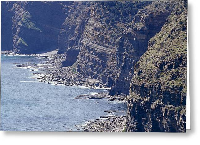 Vertigo Greeting Cards - A Rugged And Eroded Sheer Cliff Face Greeting Card by Jason Edwards