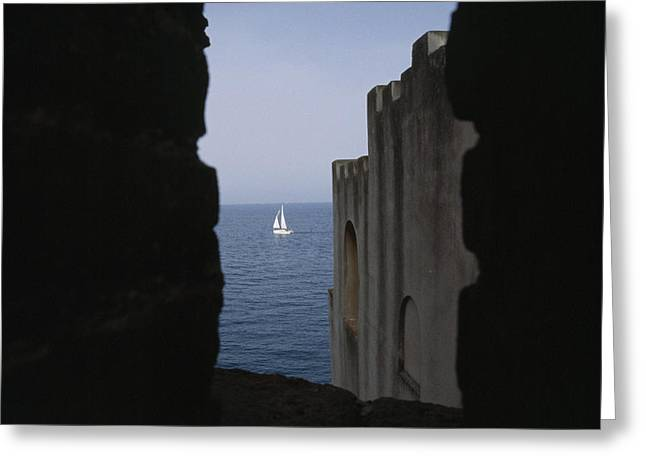 Languedoc Greeting Cards - A Sailboat Framed Between Two Buildings Greeting Card by Gina Martin