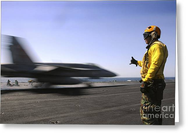 Enterprise Greeting Cards - A Sailor Ensures An Fa-18c Hornet Greeting Card by Stocktrek Images