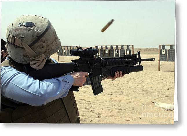 Marksman Greeting Cards - A Sailor Fires A Weapon Greeting Card by Stocktrek Images