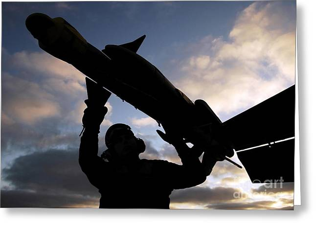 F-18 Greeting Cards - A Sailor Inspects A Captive Air Greeting Card by Stocktrek Images