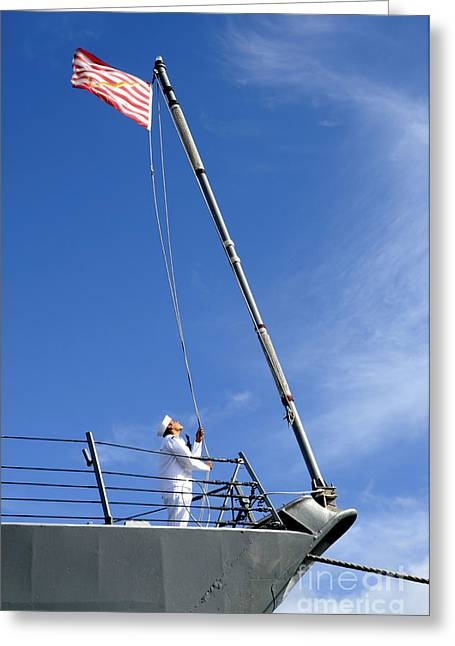 A Sailor Lowers The U.s. Navy Jack Greeting Card by Stocktrek Images