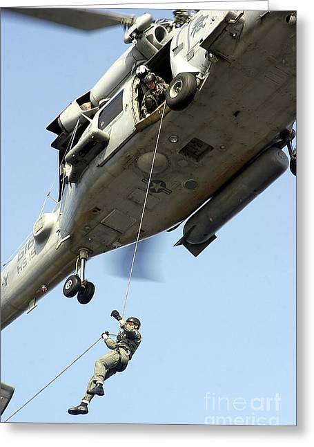 Rappel Greeting Cards - A Sailor Rappels To The Flight Deck Greeting Card by Stocktrek Images