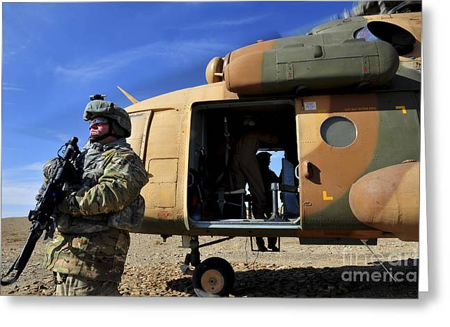Holding Gun Greeting Cards - A Security Forces Airman Covers Greeting Card by Stocktrek Images