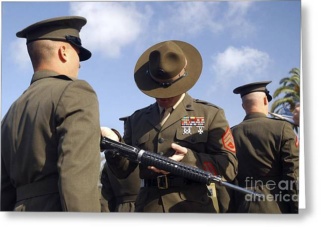 A Senior Drill Instructor Inspects Greeting Card by Stocktrek Images