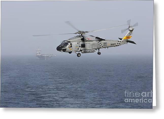 Arabian Sea Greeting Cards - A Sh-60j Seahawk During A Vertical Greeting Card by Gert Kromhout