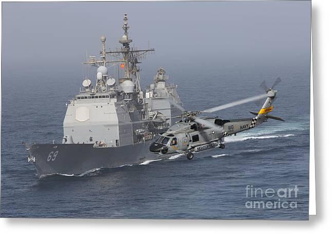Vicksburg Greeting Cards - A Sh-60j Seahawk Flys By Uss Vicksburg Greeting Card by Gert Kromhout