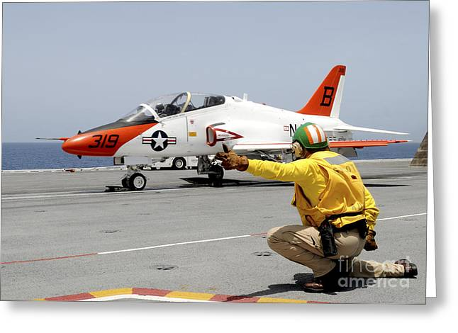 Naval Aircraft Greeting Cards - A Shooter Signlas The Launch Of A T-45a Greeting Card by Stocktrek Images