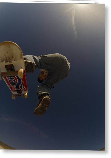 By Humans Greeting Cards - A Skateboarder Jumping At A Skate Park Greeting Card by Bill Hatcher