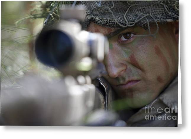 Sharpshooter Greeting Cards - A Sniper Sights In On A Target Greeting Card by Stocktrek Images