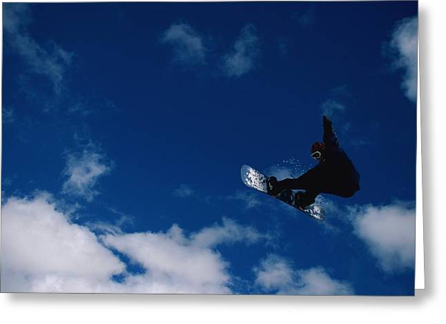 Sporting Goods Greeting Cards - A Snowboarder Launches In The Air Greeting Card by Barry Tessman
