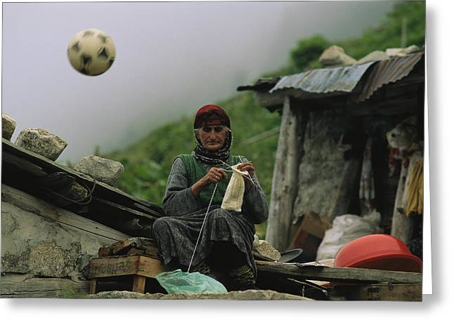 Ethnic And Tribal Peoples Greeting Cards - A Soccer Ball Flies Over The Head Greeting Card by Randy Olson