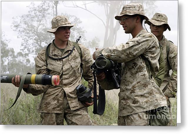 Assault Weapons Greeting Cards - A Soldier Assists A Mortarman Greeting Card by Stocktrek Images