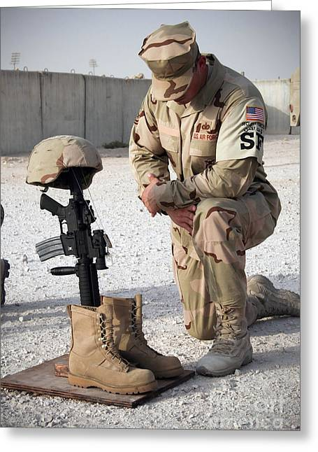 Patriotic Photography Greeting Cards - A Soldier Bows To Pay Tribute Greeting Card by Stocktrek Images
