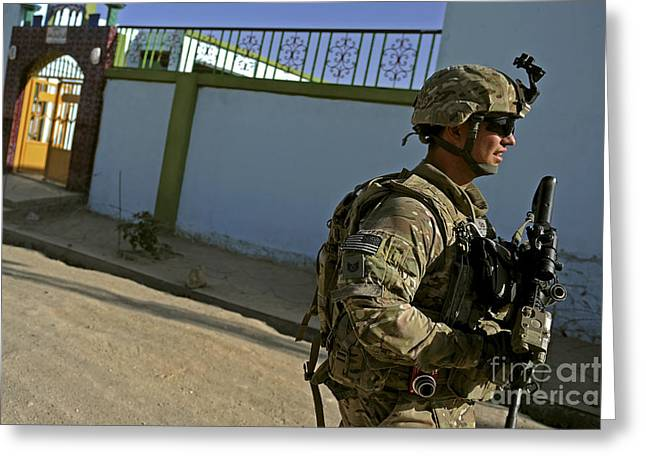 Zabul Greeting Cards - A Soldier Patrols The Streets Of Qalat Greeting Card by Stocktrek Images