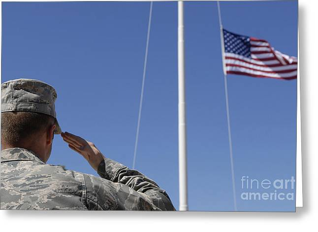 Gestures Greeting Cards - A Soldier Salutes The American Flag Greeting Card by Stocktrek Images