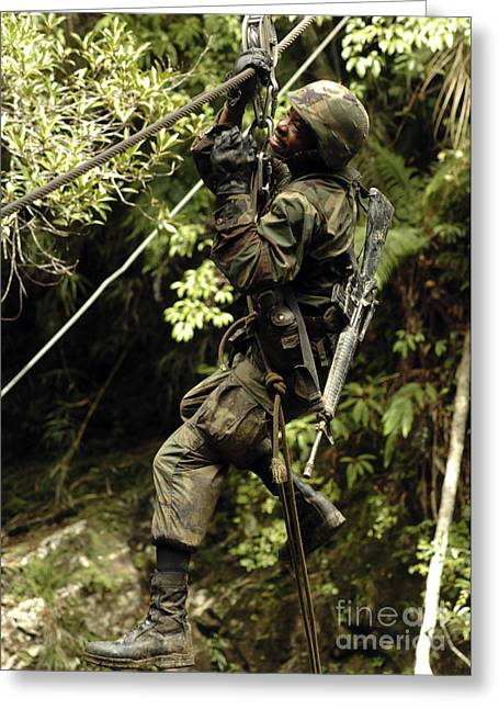 Jungle Warfare Greeting Cards - A Soldier Slides Across A River Using Greeting Card by Stocktrek Images