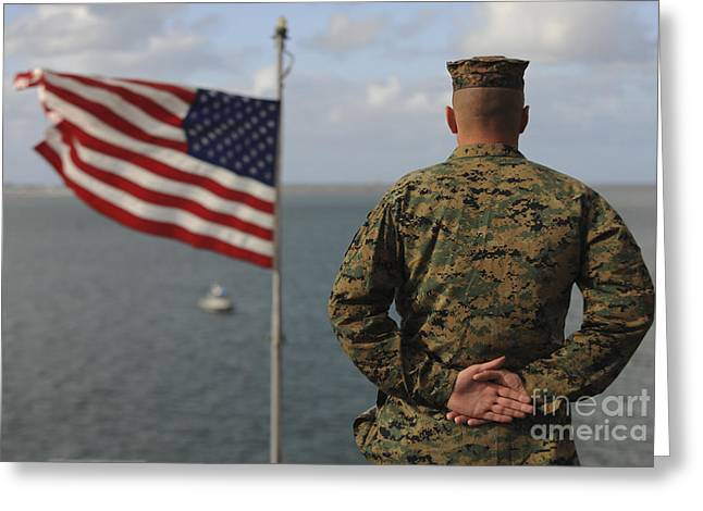 Hand On Waist Greeting Cards - A Soldier Stands At Attention On Uss Greeting Card by Stocktrek Images