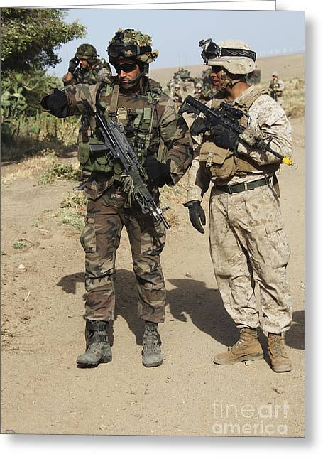 Cooperation Greeting Cards - A Spanish Marine Points Out An Greeting Card by Stocktrek Images
