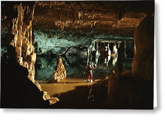 A Spelunker Explores Mil Columnas Cave Greeting Card by Bill Hatcher