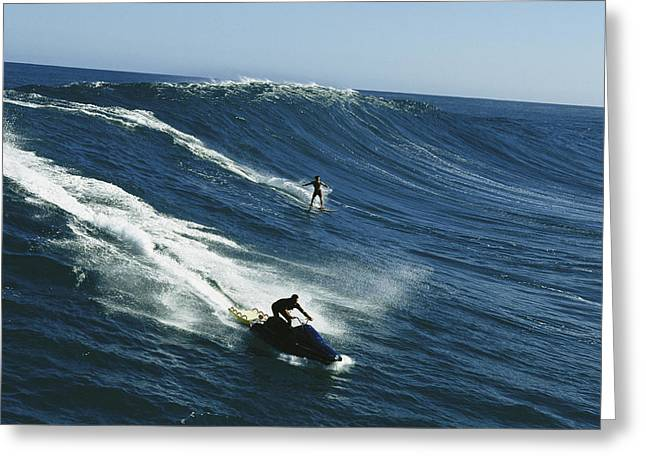 The North Greeting Cards - A Surfer And Jet-skier Off The North Greeting Card by Patrick Mcfeeley
