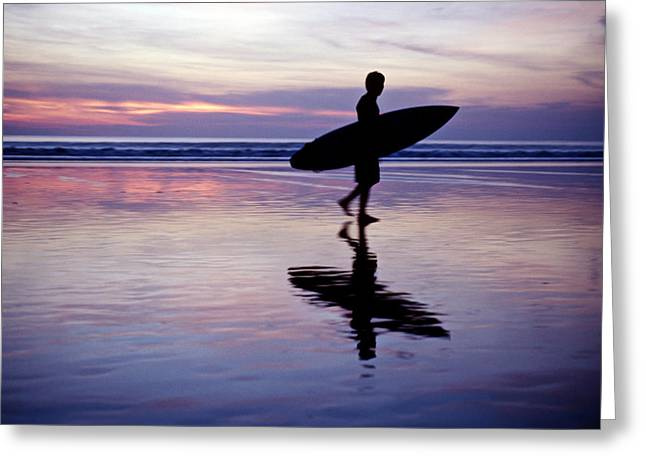 Gradations Greeting Cards - A Surfer Walks Across The Beaches Greeting Card by Justin Guariglia
