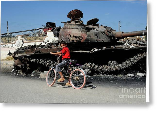 Intervention Greeting Cards - A Syrian Boy On His Bicycle In Front Greeting Card by Andrew Chittock