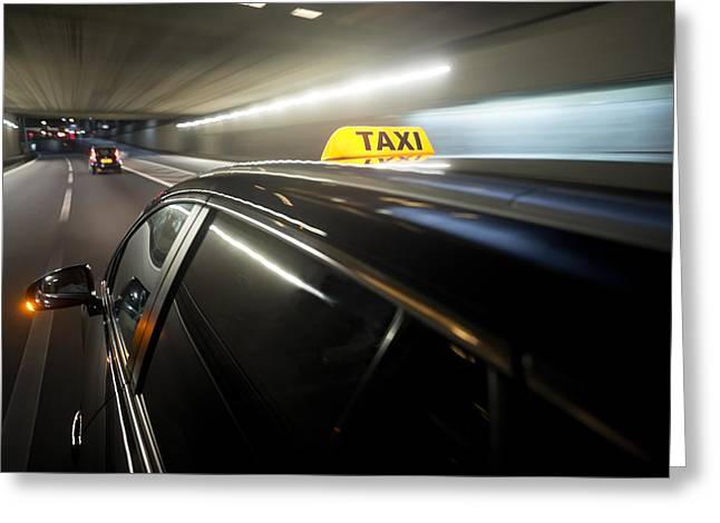 Driving Greeting Cards - A Taxi Cab Changing Lanes In A Tunnel Greeting Card by Corepics