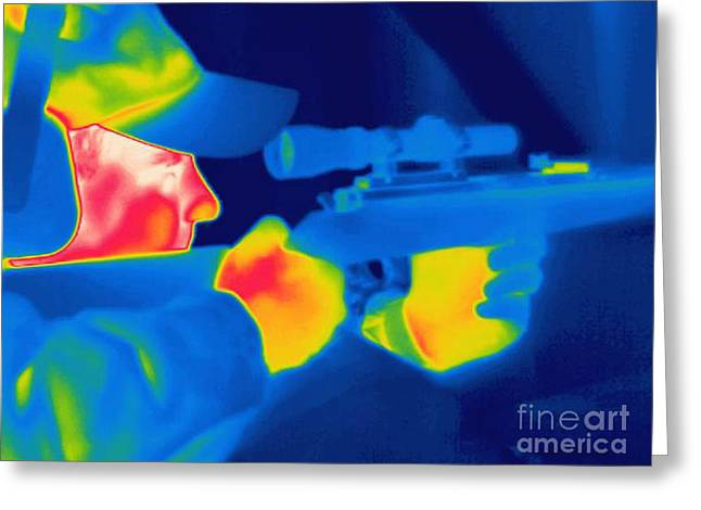 Hot Gun Greeting Cards - A Thermogram Of A Man Holding A Rifle Greeting Card by Ted Kinsman