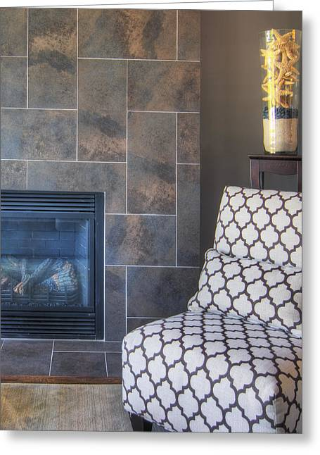 Residential Structure Greeting Cards - A Tiled Fireplace And A Single Chair Greeting Card by Nicholi Wytovicz