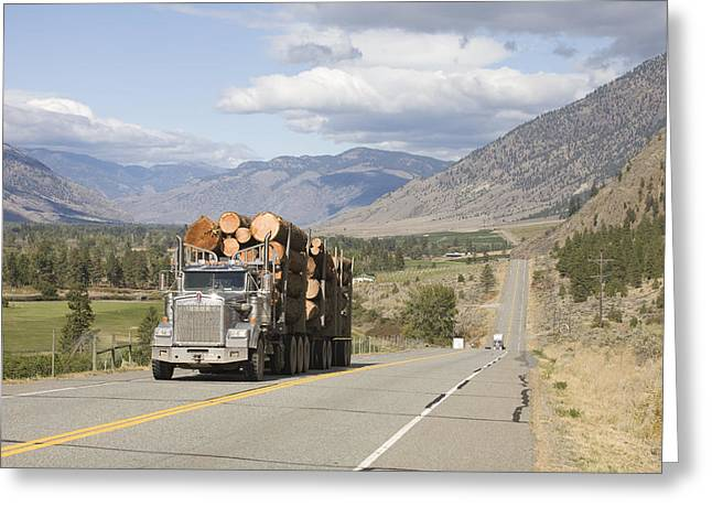 Okanagan Valley Greeting Cards - A Truck Carries Logs Down The Highway Greeting Card by Taylor S. Kennedy