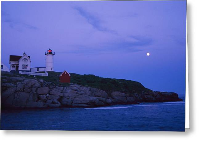 Cape Neddick Lighthouse Greeting Cards - A Twilight Moon Over The Historic Greeting Card by Stephen St. John