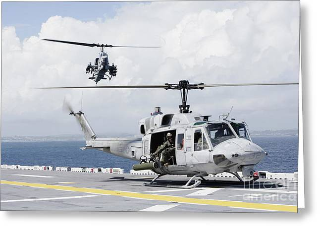 Uss Essex Greeting Cards - A Uh-1n Huey And An Ah-1w Super Cobra Greeting Card by Stocktrek Images
