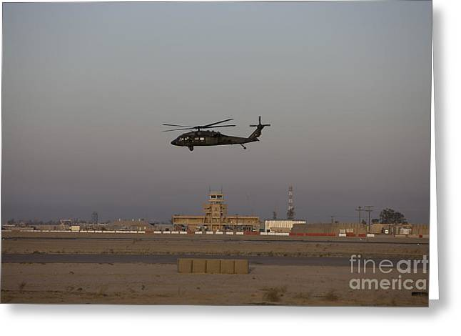 A Uh-60 Blackhawk Helicopter Flies Greeting Card by Terry Moore