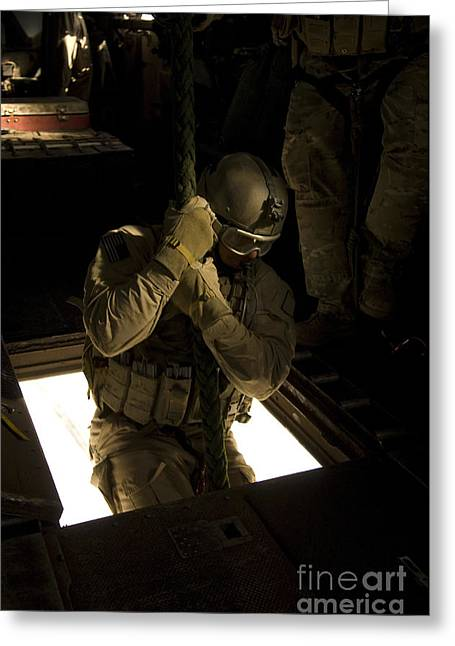 Fast Rope Greeting Cards - A U.s. Air Force Pararescueman Begins Greeting Card by Stocktrek Images