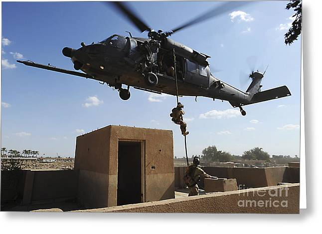 Fast-roping Greeting Cards - A U.s. Air Force Pararescuemen Fast Greeting Card by Stocktrek Images
