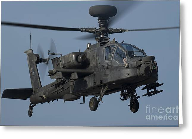 Ah-64 Greeting Cards - A U.s. Army Ah-64 Apache Helicopter Greeting Card by Stocktrek Images
