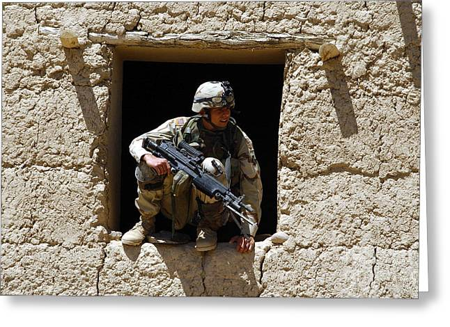 Urban Warfare Greeting Cards - A U.s. Army Soldier Exits A Window Greeting Card by Stocktrek Images