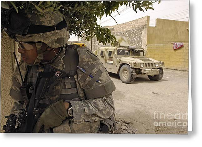 Hmmwv Greeting Cards - A U.s. Army Soldier Providing Perimeter Greeting Card by Stocktrek Images