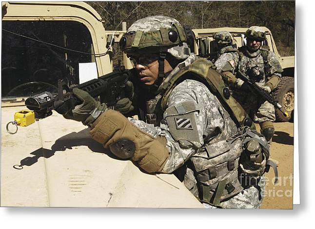 Hmmwv Greeting Cards - A U.s. Army Soldier Pulls Security Greeting Card by Stocktrek Images