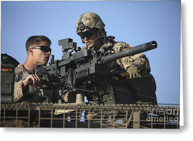 Cooperation Greeting Cards - A U.s. Marine Fires A Gmg Automatic Greeting Card by Terry Moore