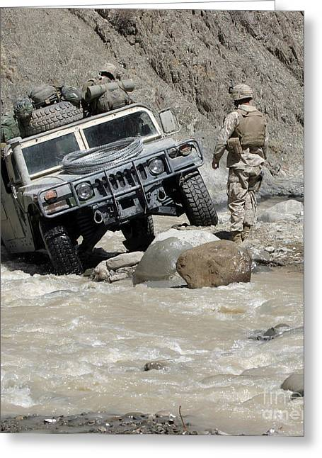 Hmmwv Greeting Cards - A U.s. Marine Guiding The Driver Greeting Card by Stocktrek Images