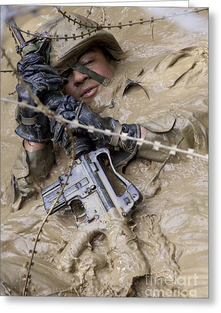 Perseverance Greeting Cards - A U.s. Marine Participates Greeting Card by Stocktrek Images