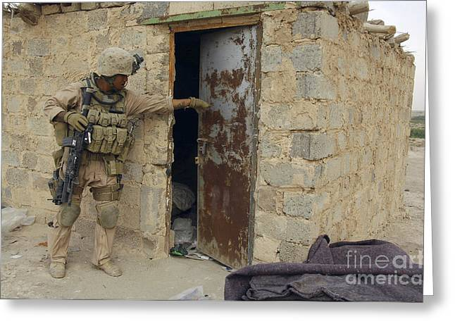 Us Open Photographs Greeting Cards - A U.s. Marine Searching Greeting Card by Stocktrek Images